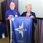 David Jibb receives the Vice-Commodore's banner from the Commodore, Mary Buchanan