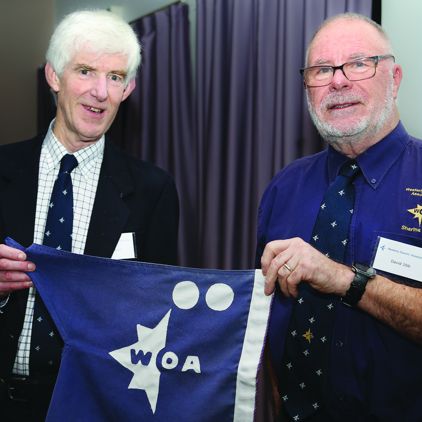 Alan Rand receives the Rear-Commodore's flag from the Vice-Commodore, David Jibb